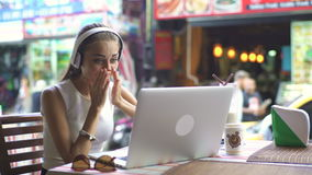 Woman On A Video Chat While Launch In Cafe. Happy young woman having video chat on laptop, , young girl is very emotional stock video