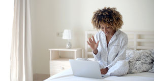 Woman Video Chatting With Friends Stock Photo