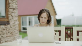 Woman video chatting outdoors stock footage