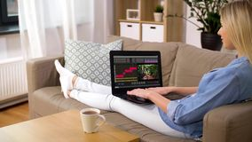 Woman with video editor program on laptop at home stock video footage