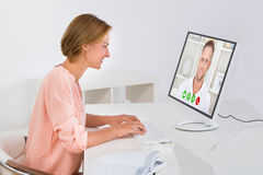 Woman Videochatting On Computer Stock Images