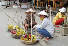 Woman in Vietnam wearing traditional triangular straw palm hats Stock Photos