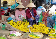Woman in Vietnam wearing traditional triangular straw palm hats Royalty Free Stock Photo