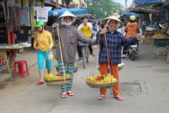 Woman in Vietnam wearing traditional triangular straw palm hats Stock Images