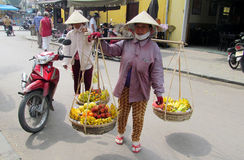 Woman in Vietnam wearing traditional triangular straw palm hats Royalty Free Stock Photography