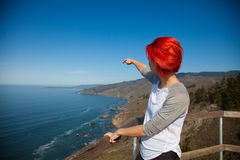 Woman on view point in sport wear. Point at something Stock Image
