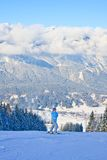 The woman at the view winter mountain. Austria Royalty Free Stock Images