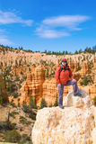 Woman viewing Bryce Canyon. A female hiker overlooking Bryce Canyon, Utah Royalty Free Stock Image