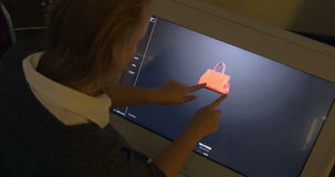Woman Viewing 3D Model of a Bag on Big Touch stock video