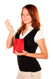 Woman viewing her gift - necklace. Zoomed out. Beautiful woman is looking at her new gift - necklace - in a red box. Zoomed out version stock photography