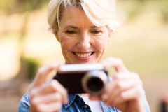 Woman viewing pictures camera Royalty Free Stock Photo
