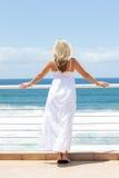 Woman viewing seascape Stock Photo