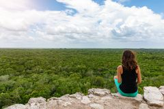Woman views over the rain forest of Yucatan, Mexico Stock Photography