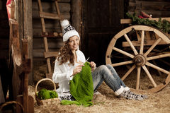 Woman in the village barn with knitting in hand Royalty Free Stock Photography