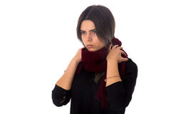 Woman with vinous scarf. Young woman with dark hair in black blouse touching her long vinous scarf on white background in studio Stock Images