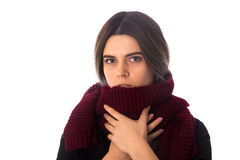 Woman with vinous scarf. Young sad woman with dark hair in black shirt with long vinous scarf on white background in studio Stock Photography