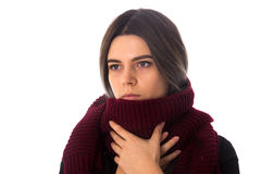 Woman with vinous scarf. Young serious woman with dark hair in black shirt with long vinous scarf on white background in studio Royalty Free Stock Photo