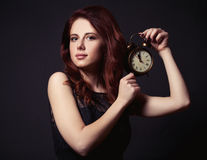 Woman with vintage alarm clock Stock Photography