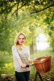 Woman on a vintage bicycle in the countryside Royalty Free Stock Image