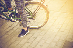 Woman on a vintage bicycle wating to ride in Barcelona, Spain Stock Photos