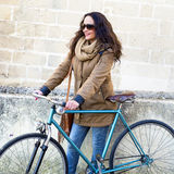 Woman with vintage bike Stock Image