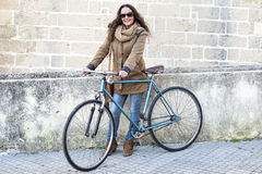Woman with vintage bike Royalty Free Stock Images
