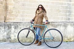 Woman with vintage bike Royalty Free Stock Photos
