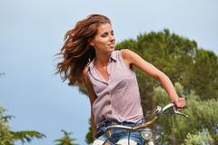 Woman with vintage bike in a country road. Stock Photos