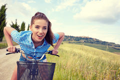 Woman with vintage bike in a country road. Royalty Free Stock Photo