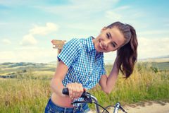Woman with vintage bike in a country road. Stock Photography