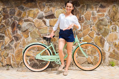 Woman with vintage bike. Stock Photography
