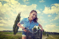 Woman with vintage bike outdoor, summer time Stock Images