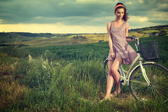 Woman with vintage bike outdoor, summer Tuscany Royalty Free Stock Photography
