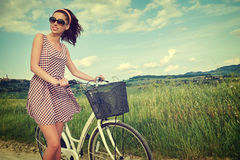 Woman with vintage bike outdoor, summer Tuscany Stock Image