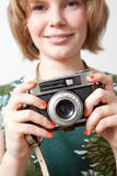 Woman with a vintage camera Stock Photo