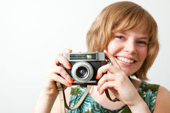Woman with a vintage camera Stock Image