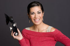 Beautiul Female Photographer Holds vintage camera Stock Photography
