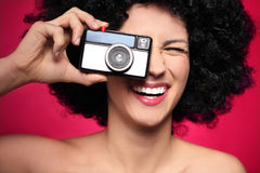Woman with vintage camera Stock Photography