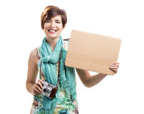Woman with a vintage camera and a cardboard. Beautiful and happy woman with a vintage camera and holding a cardboard, isolated over white background Stock Photo