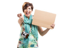 Woman with a vintage camera and a cardboard. Beautiful and happy woman with a vintage camera and holding a cardboard, isolated over white background Stock Photography