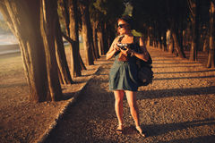 Woman with vintage camera in park alley Stock Photography