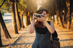 Woman with vintage camera in park alley Royalty Free Stock Photo