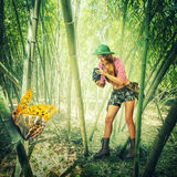 Woman with vintage camera in tropics Royalty Free Stock Photo