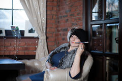 Woman in vintage clothes smoking Royalty Free Stock Image