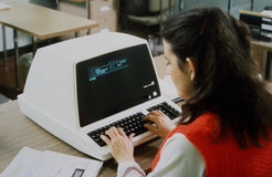 Woman at Vintage Computer Royalty Free Stock Photo