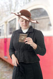 Woman in  vintage costume 1900s, old train background Stock Photo