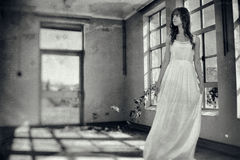 Woman in vintage creepy room stock images