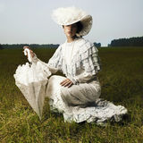 Woman in vintage dress. Photo of beautiful woman in vintage dress for promenade