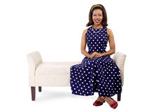 Woman in Vintage Dress and Furniture Royalty Free Stock Image