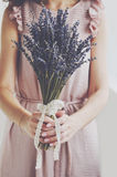 Woman in vintage dress holding bunch of lavender in her hands Stock Images